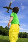 Boy Looking at Jet